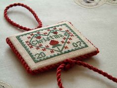 Beautiful finish on a cross stitched Christmas ornament