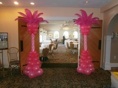 Pink feather balloon columns.  Fun!  www.Total-Party.com