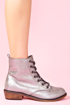 Awesome metallic silver combat boots featuring a lace-up front and faux wooden stacked heel. Bootstrap at back, fully lined. Perfect paired with a vintage tee and shredded cutoffs!