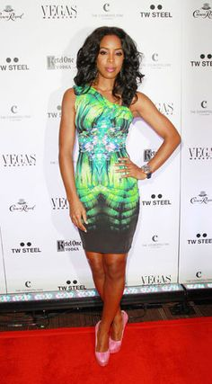 At the Vegas Magazine anniversary party, their July cover girl looked hot in a Roberto Cavalli digital print bodycon, Charlotte Olympia python pumps and a TW Steel watch.