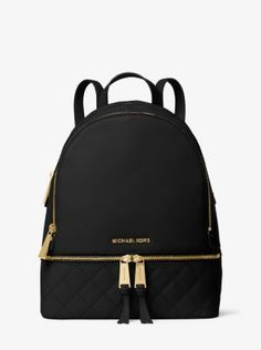 Exclusively Ours in Michael Kors stores and on michaelkors.com until 7/30/16. Laid-back yet luxe, our Rhea backpack redefines big-city accessorizing. We love the combination of a sleek quilted foundation and high-shine hardware. With its multiple zipper pockets and delicate shoulder straps, it's a feminine take on an enduring design.