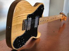 An ash Telecaster would fill out the collection nicely.