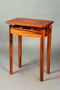 """""""Floating Top"""" table in tiger wood with ebony leg cap accents."""