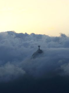 Amidst the low clouds, the statue of Jesus in Rio de Janeiro. How beautiful is this? Can you imagine seeing this from an airplane?
