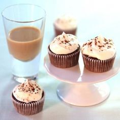 Mini cupcakes on a stand with a shot glass of Baileys