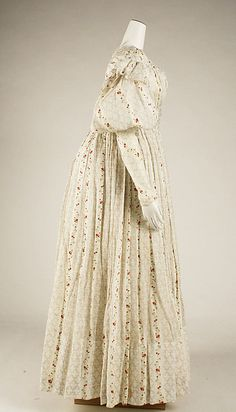 Morning dress Date: ca. 1827 Culture: British Medium: cotton  The pattern of the fabric is beautiful, though the style of the 1820s dress doesn't appeal to me particularly. I could see this as a Regency gown, worn with a burgundy Spencer, though.
