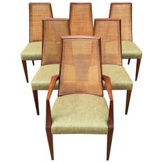 Mid-Century Modern Tall Cane Back Dining Chairs by Grosfeld House   From a unique collection of antique and modern dining room chairs at https://www.1stdibs.com/furniture/seating/dining-room-chairs/
