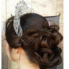 Quinceanera Hairstyles you may prefer to pull your hair up instead of leaving it down this is a great example of a beautiful updo full of curls 20 Absolutely Stunning Quinceanera Hairstyles With Crown