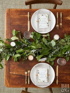 Wow your guests with this stunning greenery garland. Create bundles of eucalyptus and other greens, and attach the bundles to each other with floral wire to create a long garland. You won't believe how quick and easy it is to make this fall table centerpiece! #thanksgivingcenterpiece #fallcenterpiece #fall #thanksgivingdecorideas #bhg