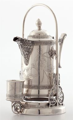 ...this Charles W. Hamill silver-plated iced tea pitcher on stand | American, late 19th century.