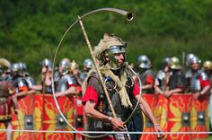 Roman Army Soldier Cornicen (Re-enactor) Marching, Ermine Street Guard, Kelmarsh Festival of History 2009, via Flickr.