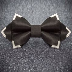 Bowtie - made out of black satin and metal corners.