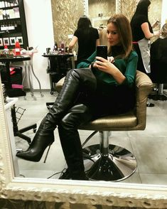 Amateur selfie black thigh boots seated in salon