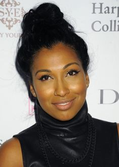 Melanie Fiona keeps it classy in her nose ring lol