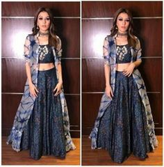 Hansika Motwani in Anoli Shah Hansika Motwani was spotted in a lovely Indo-Western outfit from designer Anoli Shah. The actress looked beautiful in navy blue lehenga and crop top paired with an organz Party Wear Indian Dresses, Indian Gowns Dresses, Dress Indian Style, Indian Fashion Dresses, Indian Designer Outfits, Indian Outfits, Designer Dresses, Fashion Outfits, Indian Wear