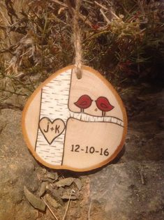Custom made wood burned birch tree ornament. Send me the initials you would like in the heart and I will make your personalized ornament. Finished product will look similar to picture but not identical due to natural variations in wood. See photos for an idea of the variety of wood slices I work with. A date can be added under the branch at no additional cost. The year (2016) or a date (12-2-14) are options. Color of the love birds can be customized upon request - please add a note when…