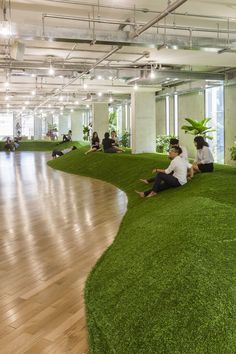 green office space by 07beach simulates park to promote productivity #officedesign
