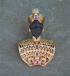 Blackamoor face is carved from ebony and the jewels are rubies.