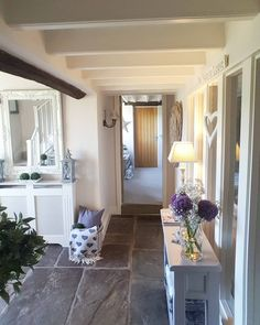 Country home Stylish modern and welcoming...stone floor...grey console...fresh flowers..