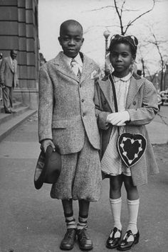 Two children wait for their parents to leave Corpus Christi Church on Easter morning Chicago,IL.1945~ Photo by Wallace Kirkland~♛