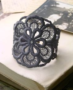 a dramatic oversized bloom adorns a dusky grey vintage lace cuff bracelet accented with antiqued brass hardware.          * length measures 7 but can