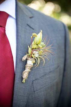 Beautiful airplant boutonniere by Bunch Studio on http://WedOverHeels.com | Photo by luluphoto.com