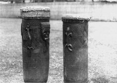 Carved wooden drums from the Chokwe people, Angola.