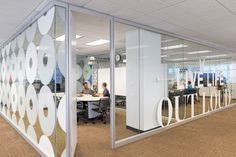 office environmental design inspiration for windows and partitions. Large letters bring the space to life
