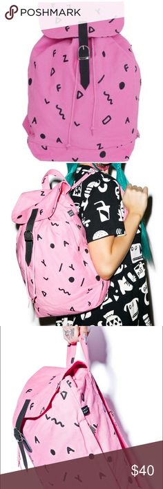 Pink Lazy Oaf Letter Rucksack This 100% cotton canvas rucksack features an allover alphabet print mixed with crazy shapes and squiggles. Too flap with belted snap fastener and drawstring. See 4th photo for small stains. Lazy Oaf Bags Backpacks