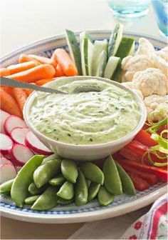 Green Goddess Dip with Spring Vegetables -- This easy, creamy Green Goddess Dip recipe is a classic accompaniment to serve with seasonal vegetables like baby carrots and sugar snap peas.