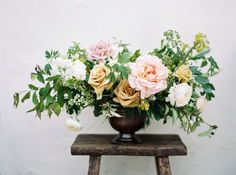 Organic garden roses summer wedding tablescape centerpiece and rustic farm bench