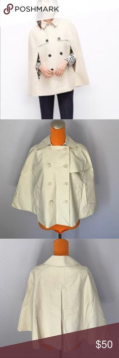 """Ann Taylor Loft Double Breasted Tan Trench Coat 26"""" length. Same as picture with light colored buttons, not the dark brown ones in picture. Light khaki/ tab cape. Retro style look. Is double breasted. Cape trench coat. Lined on inside. Has 2 front slot pockets for your arms. Excellent condition. Bundle 2+ items for a discount. LOFT Jackets & Coats Capes"""