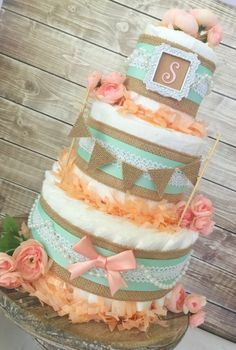 This Shabby Chic Diaper Cake is designed in the PERFECT color combination of Burlap, Mint and Peach and would make an AMAZING centerpiece at the upcoming themed baby shower! This Themed Diaper Cake would make the perfect centerpiece for the upcoming baby shower! Or to welcome the sweet bundle of j