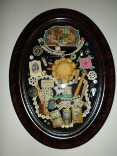 Shadow Box with Grandma's vintage sewing items in a curved glass frame.