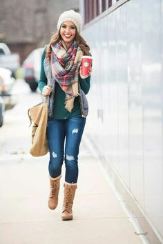 Denim distressed jeans, turquoise colored top, plaid scarf, white creme beanie