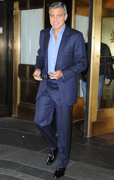 George Clooney went tie-free in a suit promoting Ides of March in NYC Wednesday. Stylish Mens Fashion, Suit Fashion, Film Man, Pinstripe Suit, Men Formal, George Clooney, Suit And Tie, Classic Outfits, Cute Guys