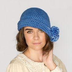 Get in touch with your inner flapper with this chic 1920's Pompom Hat! Free crochet pattern available!