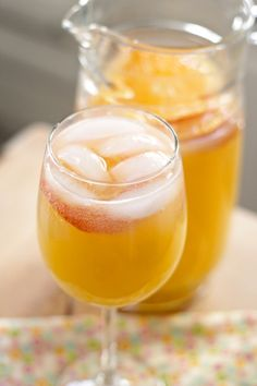White Sangria with Moscato Wine - I'd love to try this with a sparkling moscato or just plain old champagne