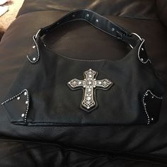Black cross bling purse Black cross bling purse. I bought it at a bike show, so cute! Trade value $20 Bags