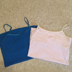 2 Aero camis 2 camis from Aeropostale, one with coral dots and one in cobalt blue• built in shelf bra• adjustable straps• no stains, holes, etc. Aeropostale Tops Camisoles