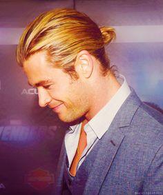 Gaebril often wears his long auburn hair pulled back.