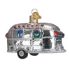 """Travel trailers are becoming more popular. Since they are towed behind a vehicle, they provide a """"home away from home"""" that is comfortable and safe, no matter where the road leads. This glass ornament"""