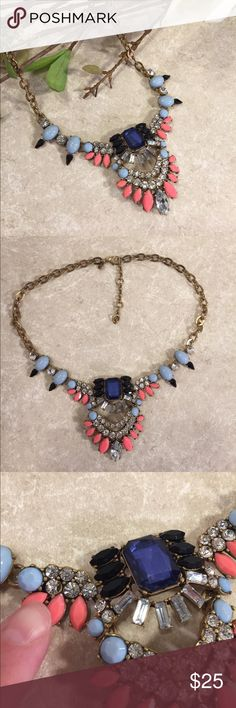 J.Crew statement necklace This is a beautiful statement necklace by J.Crew, brass type setting with jeweled pieces, colorful white peach and blue navy. See pictures for details. Good condition minor wear, one stone has small crack in it, see picture. Be sure and check out other items in closet and bundle to receive discounts. J. Crew Jewelry Necklaces