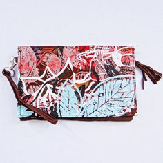 Over Print - Clutch Bags available online at www.carolenevin.com