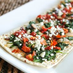 Super simple flatbread with spinach and goat cheese. Great as an app or main course!