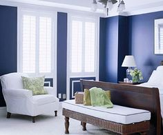 Navy and White             An easy color scheme is one solid shade plus white. Here, navy blue walls provide high contrast to white furnishings and trim