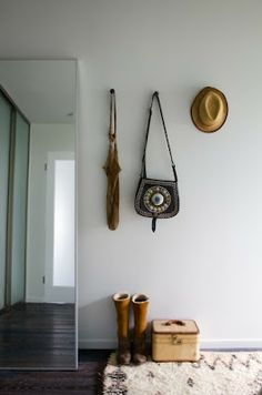 minimal | white walls | floor to ceiling mirror | wall hooks | practical home | beautiful natural light | simple | modern home | clean interiors | hardwood floors | home | living with style | stylish home | interior design | home decor | inspiration |
