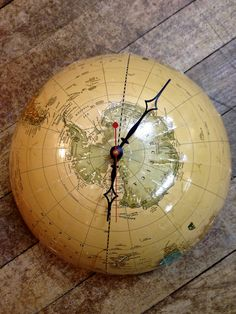 Great use of an old world globe, repurposed as a wall clock