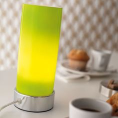 Mini green glass lamp.  http://www.worldstores.co.uk/p/Nordlux_Tube_Mini_Green_Glass_Table_Lamp.htm