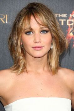 The Hunger Games star Jennifer Lawrence is bang on trend with her shoulder-length lob. A lovely combination of tousled, glossy locks and short, wispy bangs, this 'do is young, fresh, and feminine. You can also add some subtle highlights to give your hair even more impact.